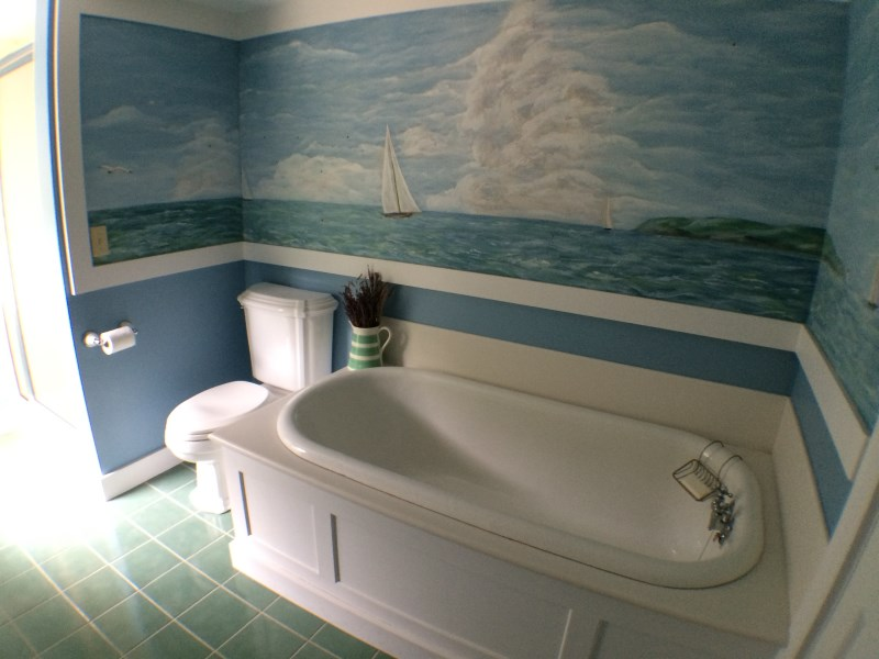 Bathtub with painting from original house